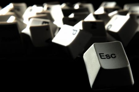 esc: esc key escaping from crowd of keyboard keys on darkness