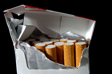 desperation: pack of cigarettes opened with desperation Stock Photo