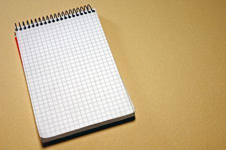 spiral notepad on beige background photo