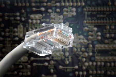 rj45 plug macro shoot with electronic board on background photo
