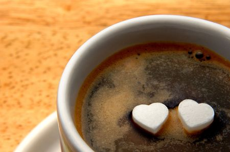 cup of coffee with two hearts on surface Standard-Bild