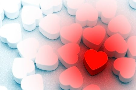curare teneramente: lotti delle caramelle di figura del cuore da sopra Archivio Fotografico