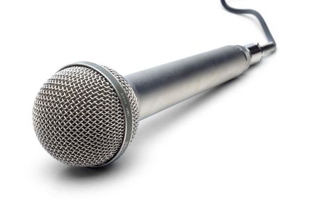 Professional microphone with attached cable on white background