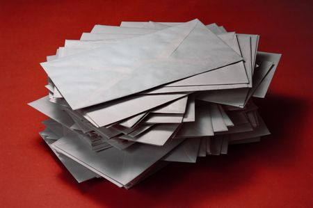 email lists: pile of envelopes over red background