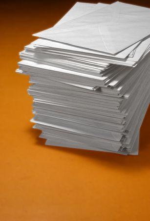 addressee: pile of envelopes over orange background