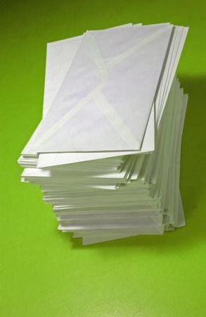 pile of envelopes over orange background