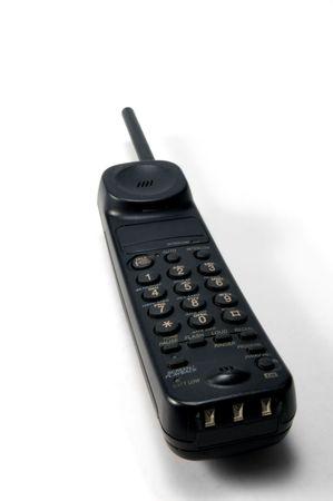 mobilephones: black phone handset over white background