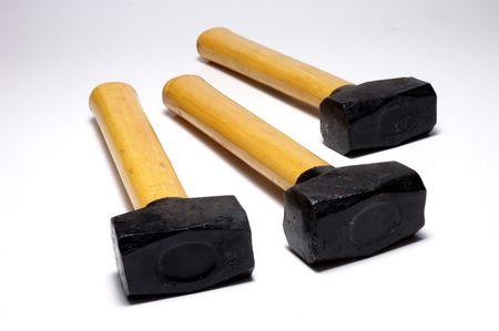 Three wood hammers on white background Stock Photo - 1050321
