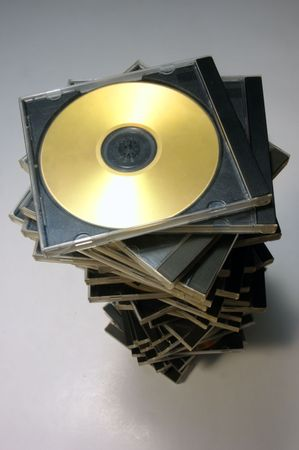 Long stack of classic CDDVD case with golden disc from above