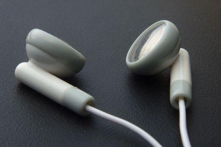close up of headphones on dark background