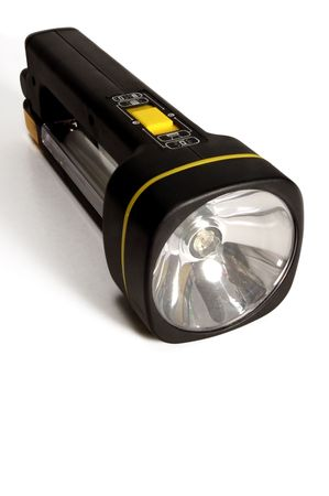 plastic flashlight on light background