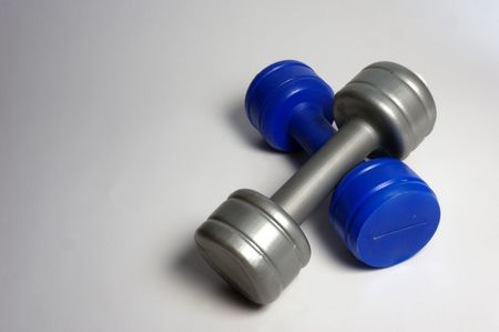 two plastic dumbbells from above Stock Photo