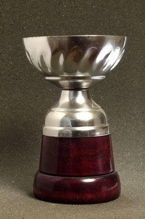 silver cup on dark background, front view