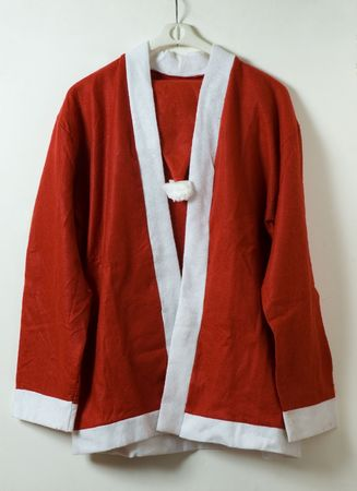 santa claus costume on hanger over white background Stock Photo