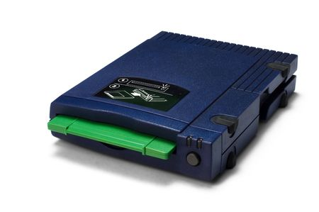 zip drive with green disk inserted over white background Stock Photo