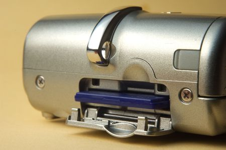 megapixel: Digital photo camera on beige background close up on memory card