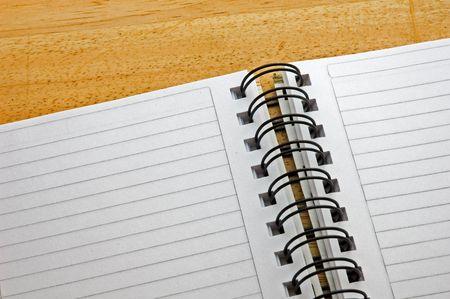 bind: spiral notepad on wooden background