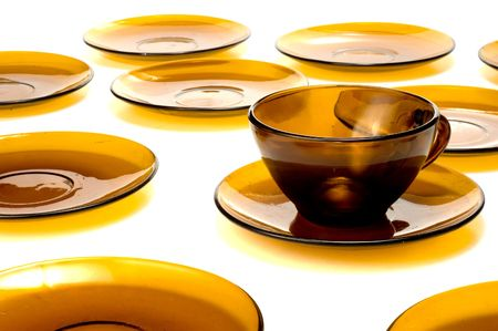 cup surrounded by lots of plates Stock Photo