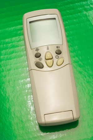 air conditioner remote control over green background