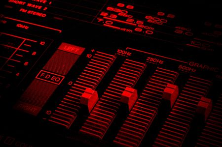 tune: graphic equalizer close up in red tones and with dramatic light