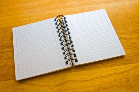 spiral notepad on wooden background photo