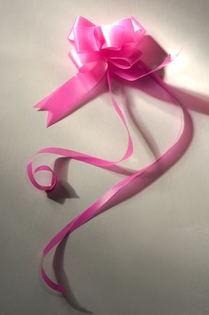 pink bow on white background with dramatic light Stock Photo