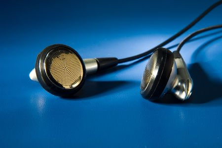 close up of headphones on blue background Stock Photo - 2863972