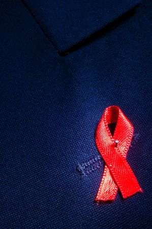 aids ribbon attached to blue jacket, with copy space