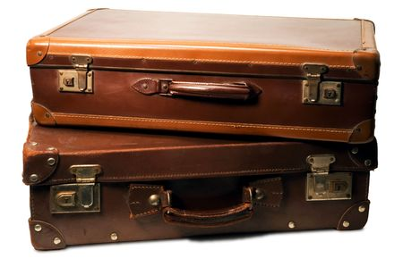 two brown leather suitcases on white background