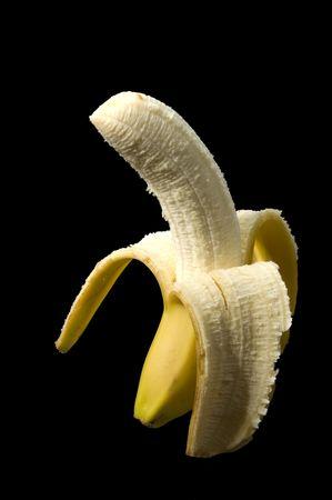 open banana on black background