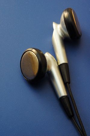 close up of headphones on blue background photo