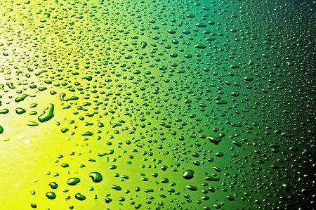 aqueous: waterdrops on yellow green faded background from above