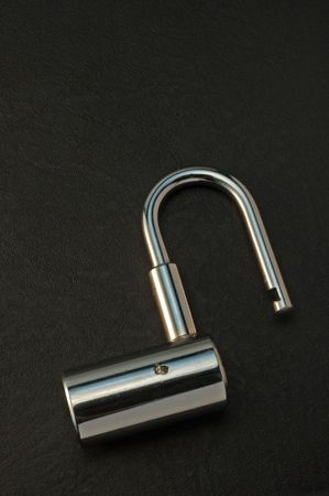 meshed: open padlock over meshed background