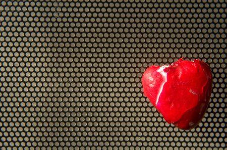 broken heart over metallic meshed background