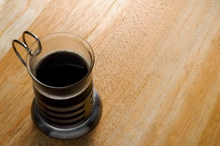 one cup of coffee over wooden table from above