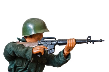 green plastic soldiers: toy soldier on white background  Stock Photo
