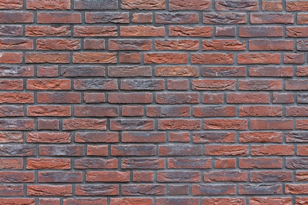 Close-up red blue purple tinted brick wall 스톡 콘텐츠