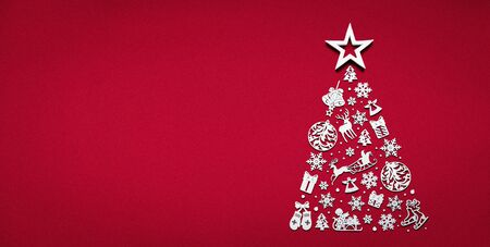 Merry christmas tree concept made of white 2020 happy new year decorations star isolated on red background table minimal flat lay, xmas winter holiday party, top down view, copy space, wide banner