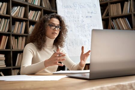 Female hispanic school math teacher virtual teaching by zoom conference call.