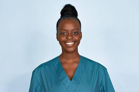 Happy young female african scrub nurse wear blue uniform isolated on background.