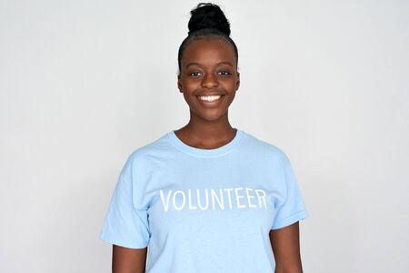 Happy african woman activist wear volunteer tshirt isolated on grey background.
