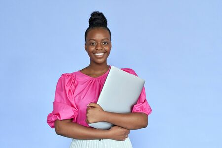 Smiling african woman student hold laptop look at camera on violet background.