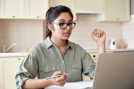 Indian woman teacher or student watching webinar or making video call.