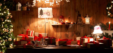 Decorated xmas table with Christmas gifts and tree in cozy Santa home, banner.