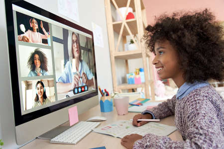 African kid girl distance learning during online group class with teacher.