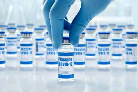 Covid 19 vaccine vial bottles, corona virus cure manufacture concept.