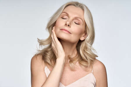Skin care ads portrait of beautiful 50 years old woman isolated on white.
