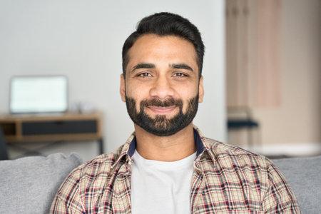 Headshot portrait of smiling attracting indian businessman indoors. 免版税图像