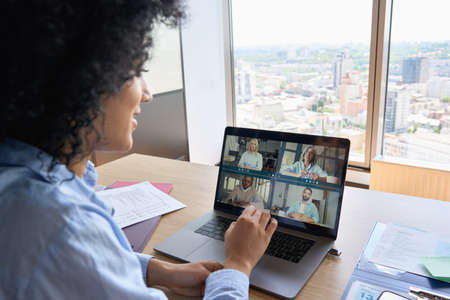 African American businesswoman having working video call in global office. 免版税图像