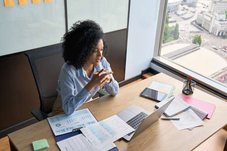 African American businesswoman having working video call in office.